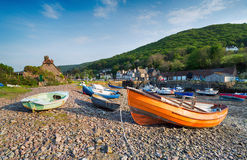 Porlock Weir on the Exmoor Coast. Colourful fishing boats on the shore at Porlock Weir a picturesque village on the Exmoor coast in Somerset Royalty Free Stock Photo