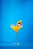 Porn Star Martini. Summer  Cocktail -  Pornstar Martini. Drink with Passion fruit, Vodka, Liquor, Vanilla Syrup, Champagne and Lime Juice. Tropical Leaf on Royalty Free Stock Image