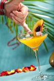 Porn Star Martini. Summer  Cocktail -  Pornstar Martini. Drink with Passion fruit, Vodka, Liquor, Vanilla Syrup, Champagne and Lime Juice. Tropical Leaf on Stock Image