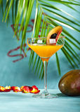 Porn Star Martini. Summer  Cocktail -  Pornstar Martini. Drink with Passion fruit, Vodka, Liquor, Vanilla Syrup, Champagne and Lime Juice. Tropical Leaf on Royalty Free Stock Photography