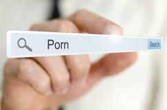 Pornografía de la palabra escrita en barra de la búsqueda Fotos de archivo libres de regalías