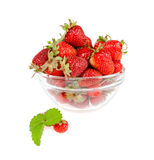 Pornography with leaves lying on the background of a plate. With strawberries on a white background Stock Photos