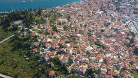 Poros. Greece. Aerial 4K video footage. Down town hills and mountains. Amazing nature and cozy architecture. tiled roofs. Of the old European city. Vacation and stock video