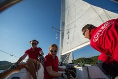 Sailors participate in sailing regatta 20th Ellada Autumn 2018 among Greek island group in the Aegean Sea. POROS, GREECE - OCT 9, 2018: , in Cyclades and Saronic stock images