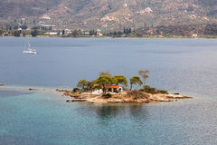 Poros Island Islet. A little islet with a church on it, in the straight between the island of Poros and mainland Greece stock image