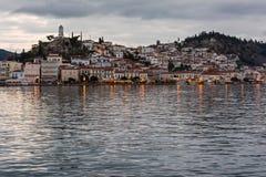 Poros wyspa przy półmrokiem, Grecja Obrazy Royalty Free