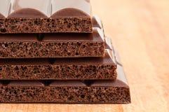 Porous black chocolate Stock Photos