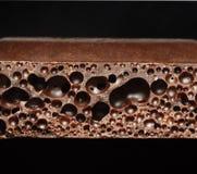 Porous chocolate. Isolate on black Royalty Free Stock Photo