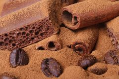Porous chocolate and ground coffee and beans, cinnamon closeup Royalty Free Stock Photo