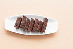 Porous chocolate on a plate Stock Images