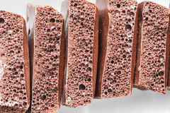 Porous chocolate on a plate Royalty Free Stock Image