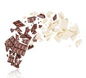 Porous dark and milk chocolate broken into many pieces in the air stock photo