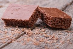 Porous milk chocolate and crumb Stock Photography