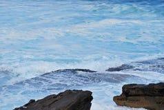 Porous rock and lots of sea foam in azure water at Bondi Beach Royalty Free Stock Photos