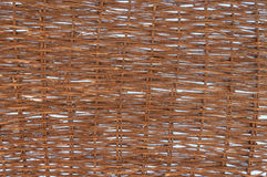 Porous Woven Sun Shelter Made from Natural Fibers. Sunlight peaks through the handmade, profusely woven, natural fibers of a screen made for protection from the royalty free stock photo