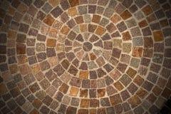Porphyry stone floor called Sanpietrini or Sampietrini. Circular texture of porphyry stone floor called Sanpietrini or Sampietrini, typical urban paving in Italy stock photo