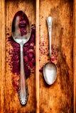 Porpora e cucchiai Fotografie Stock