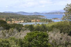 the Porquerolles Island with its port and its green and luxuriant vegetation royalty free stock photo