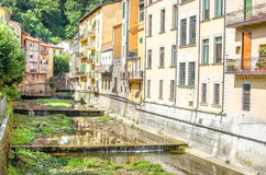 Porretta - Bologna - Reno river tributary canal  passing passes through village house Royalty Free Stock Photography
