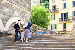 Porretta Terme - August 2, 2015 - Two women help a small child t. O climb stairs royalty free stock images