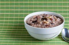 Porridge. A bowl of porridge,green background Royalty Free Stock Photos