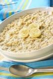 Porridge. Bowl of porridge, with banana and honey.  A sunny, healthy oatmeal breakfast Stock Photo