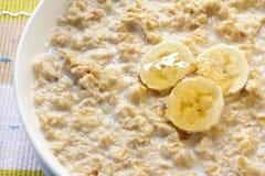 Porridge. With banana and honey.  Traditional Scottish oatmeal Stock Photos