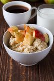 Porridge with apple. Healthy breakfast oatmeal with apples and cinnamon Royalty Free Stock Image