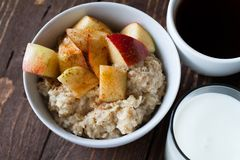 Porridge with apple. Healthy breakfast oatmeal with apples and cinnamon Royalty Free Stock Photos