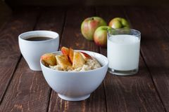 Porridge with apple. Healthy breakfast oatmeal with apples and cinnamon Royalty Free Stock Photography