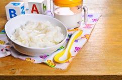 Porridge for baby food Stock Photos
