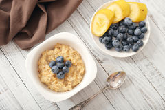 Porridge with bananas and blueberry Royalty Free Stock Image