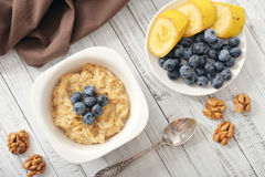 Porridge with bananas and blueberry Stock Photos