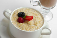 Porridge with berries closeup Stock Photos