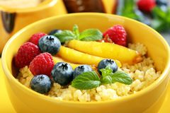 Porridge with berries and fruits - healthy breakfa Stock Image