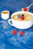 Porridge and berries with honey Royalty Free Stock Photo
