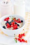 Porridge with berries and milk Stock Photo