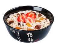 Porridge  in black dish Stock Images
