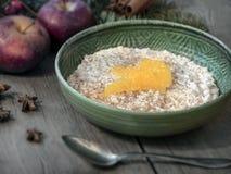 Porridge in a blue bowl stock photo