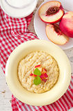 Porridge in a bowl Stock Photo