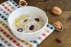 Porridge in a bowl with walnuts and berries Royalty Free Stock Photo
