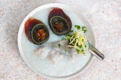 Porridge with century egg or preserved duck eggs. Stock Photo