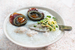 Porridge with century egg or preserved duck eggs. Stock Image