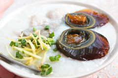 Porridge with century egg or preserved duck eggs. Stock Photos