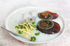 Porridge with century egg or preserved duck eggs. Stock Images