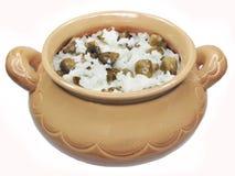 Porridge in clay pot with mushrooms Stock Photos