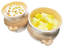 Porridge in clay pots with honey and raisin Royalty Free Stock Images