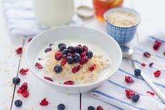 Porridge with cranberries Stock Photo
