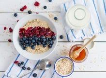 Porridge with cranberries Stock Photos