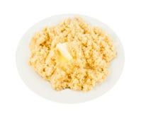Porridge del miglio con burro Fotografia Stock Libera da Diritti